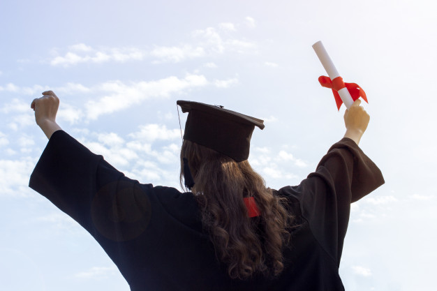 graduate-put-her-hands-up-celebrating-with-certificate_79075-15